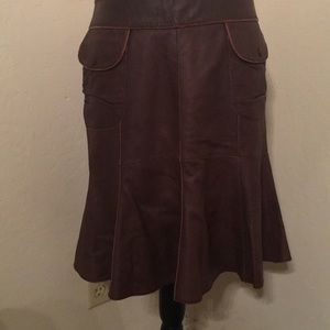 Leather skirt with silk lining.